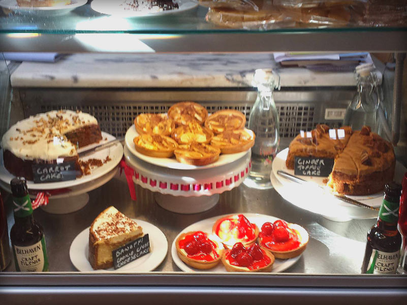 Shop Counter fridges with Carrot Cake, Ginger Toffee Cake and Strawberry Tarts
