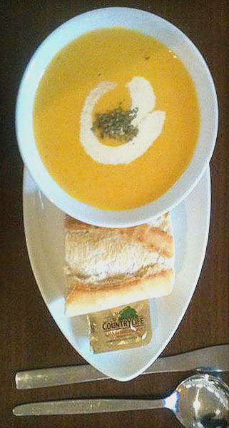 Soup of the day with crusty bread roll and butter